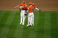 Infielders Sam Hall (5), Logan Davidson (8), Jordan Greene (9) and Grayson Byrd (4) of the Clemson Tigers jump in celebration of their 6-2 win over the South Alabama Jaguars on Opening Day, Friday, February 15, 2019, at Doug Kingsmore Stadium in Clemson, South Carolina. (Tom Priddy/Four Seam Images)