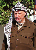 Palestinian Authority Chairman Yasser Arafat listens to United States President Clinton's remarks welcoming him to the Wye River Summit with Israeli Prime Minister Netanyahu in the Rose Garden at the White House on Thursday, October 15, 1998..Credit: Ron Sachs / CNP