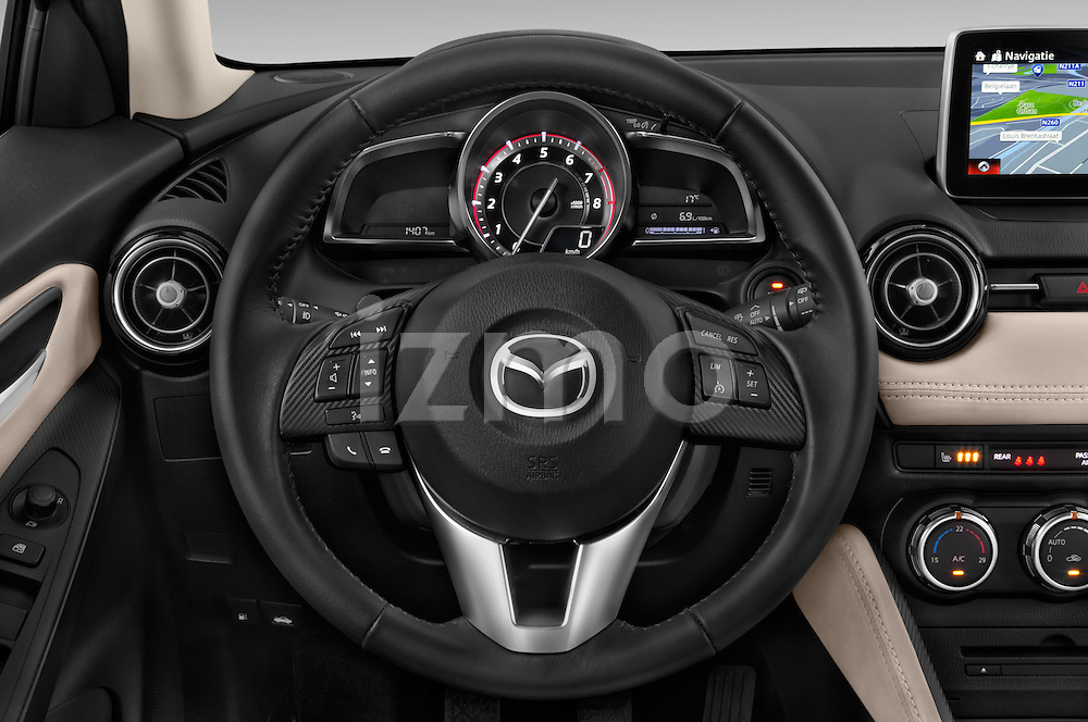 Car pictures of steering wheel view of a 2015 Mazda Mazda2 Pulse Edition 5 Door Hatchback 2WD Steering Wheel