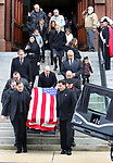 WATERBURY CT. 31 December 2018-123118SV04-Family and friends follow pallbearers as the carry Zeqir &quot;Ziggy the Flag Man&quot; Berisha out of St. Francis Xavier Church during his funeral in Waterbury Monday. <br /> Steven Valenti Republican-American