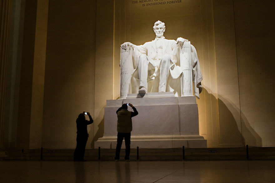 Tourists inside the Lincoln Memorial,  built to honor the 16th President of the United States, Abraham Lincoln.  It is located on the National Mall in Washington, D.C. ..Photo by Brooks Kraft/Corbis.....................