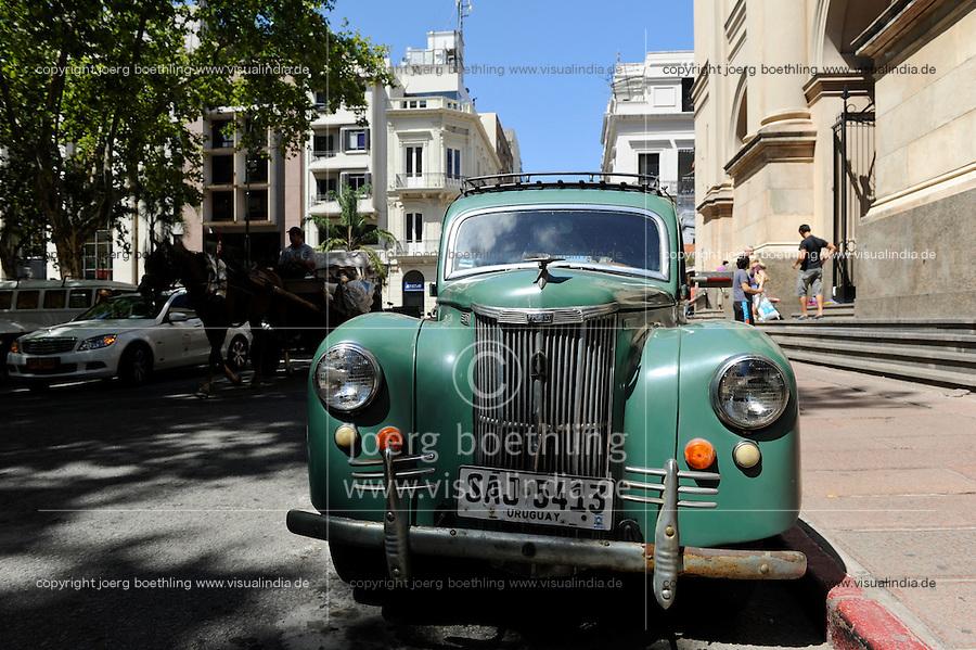 URUGUAY Montevideo, Constitución Square, old car in front of Metropolitan Basilica, opened in 1804