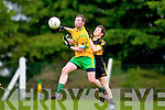 David O'Leary of Dr Crokes punches the ball away from Gneeveguilla's Gerard Moynihan in Gneeveguilla last Sunday evening in round 1 of the Garvey's Supervalue County Senior Championship.