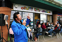 Pictured: An Elvis Presley impersonator performs outside a cafe at Porthcawl seafront. Friday 22 September 2017<br />