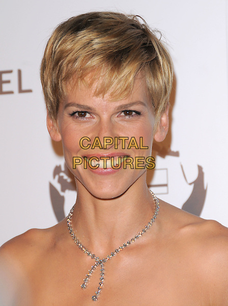 HILARY SWANK .Attending The Nakheel Introduction of The Trump International Hotel & Tower Dubai held at The Tar Estate in Bel Air, California on August 23rd 2008.                                                                     .portrait headshot short cropped hair blonde diamond necklace .CAP/DVS.©Debbie VanStory/Capital Pictures