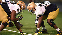 Defensive lineman Brandon Tiassum (77) defensive lineman Micah Dew-Treadway (97)
