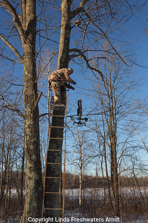 Hunter using a pull up cord to retrieve his crossbow