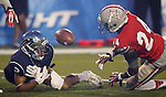 Nevada's Richy Turner and UNLV's Fred Wilson try to come up with a loose ball during the second half of an NCAA college football game in Reno, Nev., on Saturday, Oct. 26, 2013. UNLV defeated Nevada 27-22.<br /> Photo by Cathleen Allison