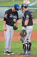 Missoula Osprey Bud Jeter (40) and Stryker Trahan (36) talk at the mound during action against the Ogden Raptors in Pioneer League play at Lindquist Field on July 17, 2013 in Ogden Utah. (Stephen Smith/Four Seam Images)