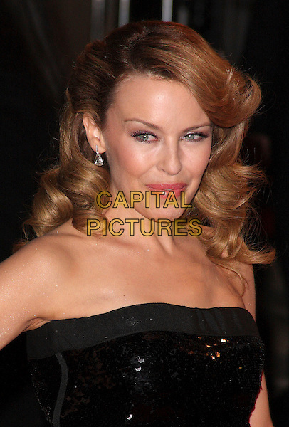 KYLIE MINOGUE.Arrivals - 2009 Brit Awards, Earls Court, London, England. .February 18th 2009. .brits headshot portrait strapless shiny sequined sequins black.CAP/ROS.©Steve Ross/Capital Pictures.