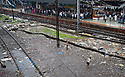 Mumbai, India<br /> Bandra area slums - Boys playing cricket in torrential rain on  rubbish strewn area near the tracks<br /> <br /> Picture by Gavin Rodgers/ Pixel8000<br />  07917221968