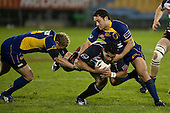 Niva Ta'auso is taken to ground by Brett Mather & Aaron Bancroft. Air New Zealand Cup rugby game played at Mt Smart Stadium, Auckland, between Counties Manukau Steelers & Otago on Thursday August 21st 2008..Otago won 22 - 8 after leading 12 - 8 at halftime.