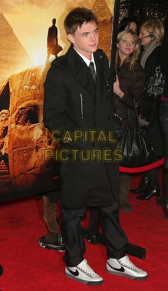 "JESSE McCARTNEY.Premiere of ""Jumper"" at the Ziegfeld Theater, New York, NY, USA..February 11th, 2008.full length black coat hand in pocket.CAP/LNC/TOM.©TOM/LNC/Capital Pictures."