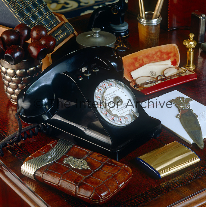 On the Duke of Windsor's antique mahogany desk -  itself a relic of Fort Belvedere, his house in England - is an old-fashioned black telephone, a jar containing his pipes and a cigar case which once belonged to his grandfather, Edward VII