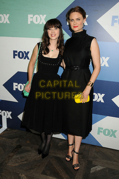 Zooey Deschanel, Emily Deschanel<br /> Fox All-Star Summer 2013 TCA Party held at Soho House, West Hollywood, California, USA, 1st August 2013.<br /> full length dress vintage sleeveless retro green chanel bag chain strap black tights yellow clutch sisters family siblings high neck sleeveless <br /> CAP/ADM/BP<br /> &copy;Byron Purvis/AdMedia/Capital Pictures
