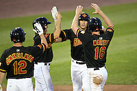 Rochester Red Wings Shortstop Trevor Plouffe (1) is congratulated by Brian Dinkelman (12), Wilson Ramos, and Dustin Martin (16) after hitting a home run during a game vs. the Louisville Bats Friday, May 14, 2010 at Frontier Field in Rochester, New York.   Rochester defeated Louisville by the score of 13-4.  Photo By Mike Janes/Four Seam Images