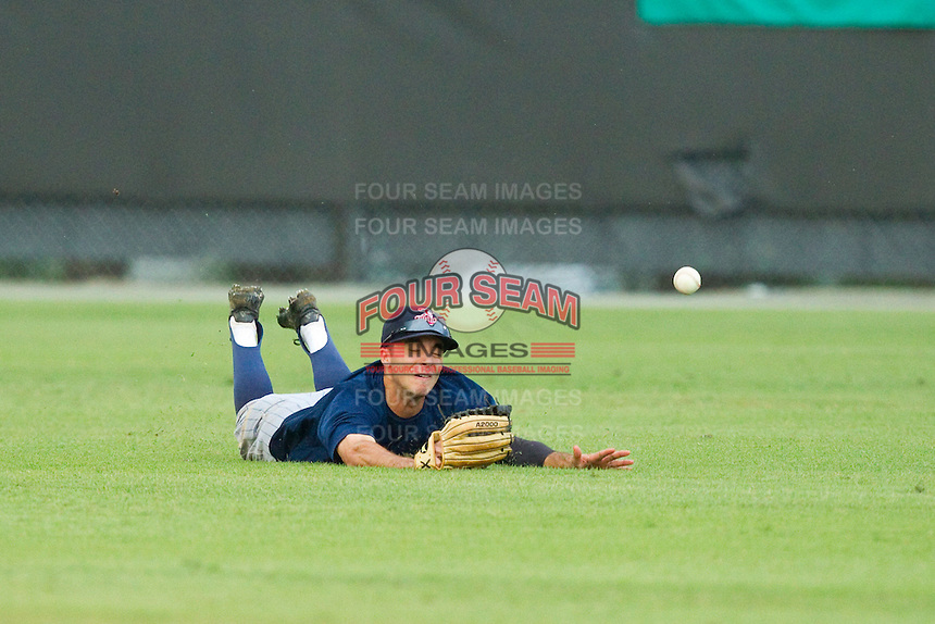Elizabethton Twins center fielder Zach Granite (20) makes a diving attempt to catch the ball during the Appalachian League game against the Burlington Royals at Burlington Athletic Park on August 11, 2013 in Burlington, North Carolina.  The Twins defeated the Royals 12-5.  (Brian Westerholt/Four Seam Images)