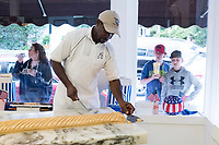 People watch as Daniel Ferguson, 50, shapes fudge at Murdick's Fudge in Edgartown, Martha's Vineyard, Massachusetts, USA, on Tues., July 25, 2017.  Ferguson is from Jamaica and has an H2B seasonal foreign worker visa. He says 2017 is his sixth summer season working in the fudge shop. During off-months, he returns to Jamaica where he can be with family and escape the cold weather. Most of the shop's workers are seasonal foreign workers. Other companies on Martha's Vineyard and around the US had difficulty obtaining H2B visas, but Murdick's Fudge received all it requested.
