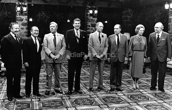 G-7 leaders pose for a group photo at the Chateau Montebello in Montebello, Quebec, Canada on July 20, 1981. From left to right: President Gaston Thorn of the European Commission, Prime Minister Zenko Suzuki of Japan, Chancellor Helmut Schmidt of West Germany, United States President Ronald Reagan, Prime Minister Pierre Elliott Trudeau of Canada, President Fran&ccedil;ois Mitterrand of France, Prime Minister Margaret Thatcher of the United Kingdom, and Prime Minister Giovanni Spadolini of Italy. Inclement weather forced the photo session to be moved indoors.<br />