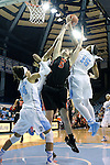 16 December 2014: Oregon State's Samantha Siegner (5) is defended by North Carolina's Allisha Gray (15) and Jessica Washington (24). The University of North Carolina Tar Heels hosted the Oregon State University Beavers at Carmichael Arena in Chapel Hill, North Carolina in a 2014-15 NCAA Division I Women's Basketball game. Oregon State won the game 70-55.