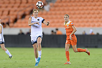 Houston, TX - Saturday July 08, 2017: Allie Long heads the ball up the field during a regular season National Women's Soccer League (NWSL) match between the Houston Dash and the Portland Thorns FC at BBVA Compass Stadium.