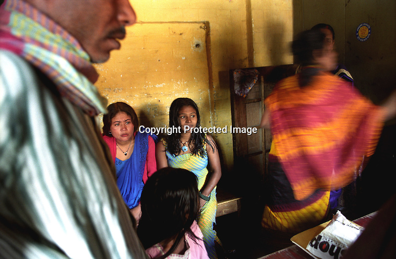 INDIA (West Bengal - Calcutta) -Sex workers and their regular customers waiting for a free health check up in a camp organised by a NGO. Kolkata, India- Arindam Mukherjee