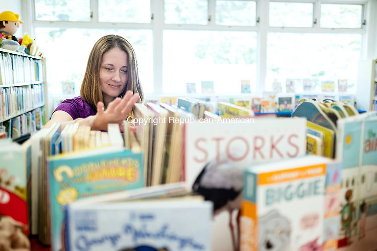Woodbury, CT- 17 August 2017-081717CM03- Head Children's librarian, Bonnie Knapik organizes books inside the Woodbury Public Library on Thursday.  The children's section of the library will undergo renovations starting next week, which includes moving over 30,000 reading and audio visual materials.    Christopher Massa Republican-American