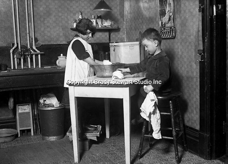 Wilkinsburg PA:  Helen and Brady Stewart Jr helping mom wash and dry the dishes - 1924