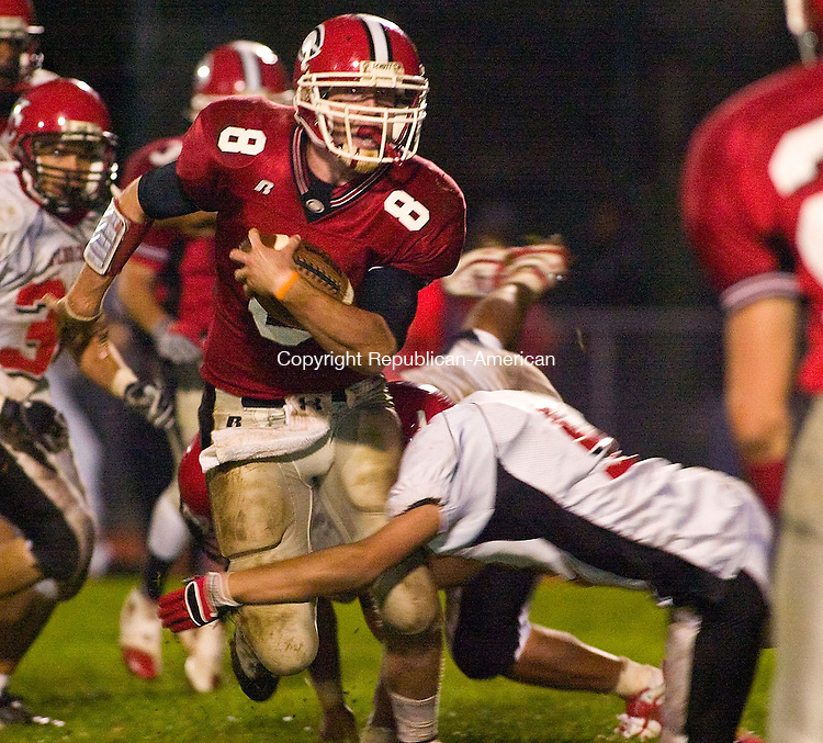 CHESHIRE, CT - 03 OCTOBER 2008 -100308JT09--<br /> Cheshire quarterback Billy Ragone is tackled by Wilbur Cross's Marcus Bentley during Friday's game at Cheshire. <br /> Josalee Thrift / Republican-American