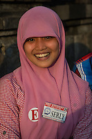 Borobudur, Java, Indonesia.  Young Indonesian Student Practicing English while Visiting the Temple.