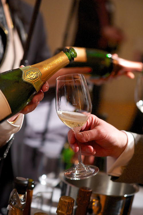 Pouring champagne at a tasting event.