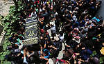 Mourners carry a casket containing the body of a Palestinian Islamic Jihad militant Abdel Halim al-Naqa, 28, who was killed in Israeli tank fire earlier in the day, during his funeral in Khan Younis in the southern Gaza strip on May 27, 2018. Photo by Ashraf Amra