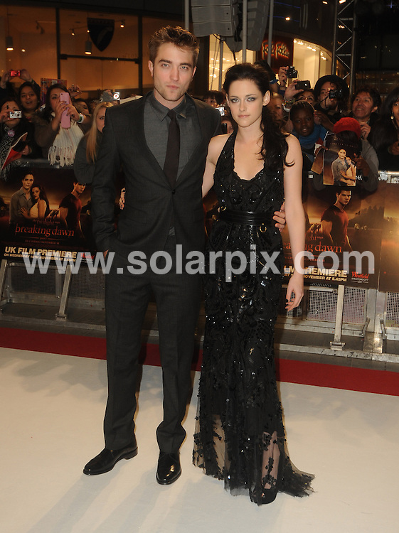 **ALL ROUND PICTURES FROM SOLARPIX.COM**                                             **WORLDWIDE SYNDICATION RIGHTS**                                                                                  UK Premiere of 'The Twilight Saga: Breaking Dawn Part 1' at Westfield Stratford City on November 16, 2011 in London                                                                           .This pic:    Robert Pattinson and Kristen Stewart                                                                                        JOB REF:    14195    LNJ       DATE:  17.11.11                                                          **MUST CREDIT SOLARPIX.COM OR DOUBLE FEE WILL BE CHARGED**                                                                      **MUST AGREE FEE BEFORE ONLINE USAGE**                               **CALL US ON: +34 952 811 768 or LOW RATE FROM UK 0844 617 7637**