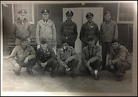 BNPS.co.uk (01202 558833)<br /> Pic: Bonhams/BNPS<br /> <br /> ***Please use full byline***<br /> <br /> 2nd Lt Russell Gackenbach during the war (back row 3rd left)<br /> <br /> A never-seen-before photograph of the infamous first atomic bomb dropped on Hiroshima in the final days of World War II has emerged for sale for &pound;30,000.<br /> <br /> The black and white snap was taken from the navigators window of the US airforce Superfortress carrying scientists and journalists to witness the arrival of the atomic age.<br /> <br /> It shows the enormous mushroom cloud rising above the city moments after bomber plane Enola Gay dropped its catastrophic payload on August 6, 1945.<br /> <br /> The poignant photo was taken by Second Lieutenant Russell Gackenbach, navigator onboard Necessary Evil, one of the three B-29 planes that took part in the attack.<br /> <br /> The grainy image of the explosion has never before been published, remaining in 2nd Lt. Gackenback's  posession until the 1990s when he sold it to a private collector.<br /> <br /> A 3-inch by 2-inch contact print of the photo is now up for sale at Bonhams alongside the Agfa Viking camera 2nd Lt. Gackenback used to take the photograph.