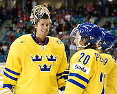 Jacob Markstrom (Sweden - 25), Andre Petersson (Sweden - 20) - Team Sweden celebrates after defeating Team Switzerland 11-4 to win the bronze medal in the 2010 World Juniors tournament on Tuesday, January 5, 2010, at the Credit Union Centre in Saskatoon, Saskatchewan.