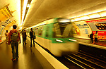 Tube train entering underground station, Metro Paris.