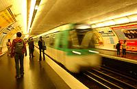 Tube train entering underground station, Metro Paris.