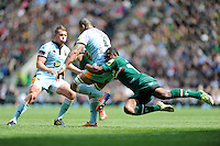 Samu Manoa of Northampton Saints is tackled by Vereniki Goneva of Leicester Tigers as Dylan Hartley of Northampton Saints looks on during the Aviva Premiership Final between Leicester Tigers and Northampton Saints at Twickenham Stadium on Saturday 25th May 2013 (Photo by Rob Munro)