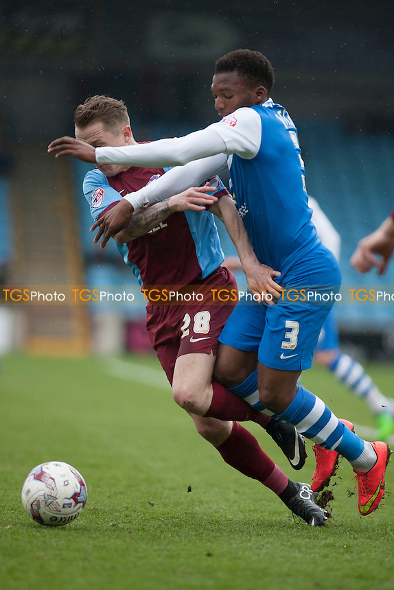 Gary McSheffrey of Scunthorpe United &amp; Kgosi Ntlhe of Peterborough U<br />  - Scunthorpe United vs Peterborough United - Sky Bet League One Football at Glanford Park, Scunthorpe, Lincolnshire - 03/04/15 - MANDATORY CREDIT: Mark Hodsman/TGSPHOTO - Self billing applies where appropriate - contact@tgsphoto.co.uk - NO UNPAID USE