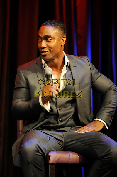 Simon Webbe<br /> Blue performing at the launch of their new single 'You Break My Heart', The Matcham Room, Hippodrome Casino, Leicester Square, London, England. <br /> 15th August 2013<br /> on stage in concert live gig performance performing music half length sitting singing grey gray suit waistcoat    <br /> CAP/MAR<br /> &copy; Martin Harris/Capital Pictures