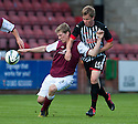 Arbroath's Colin Hamilton is pulled back by Pars' Jordan Moore.