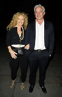"Kelly Hoppen & John Gardiner<br /> The ""Barking In Essex"" press night afterparty, The Crypt, St Martin-in-the-Fields Church, Charing Cross Rd., London, England.<br /> September 16th, 2013<br /> full length black blue blazer trousers suit white shirt couple<br /> CAP/CAN<br /> ©Can Nguyen/Capital Pictures"