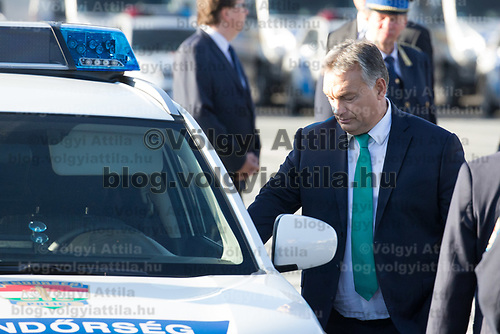 Viktor Orban prime minister of Hungary inspects new patrol cars being presented during a ceremony where police officers take oath on Heroes square in Budapest, Hungary on Oct. 9, 2017. ATTILA VOLGYI