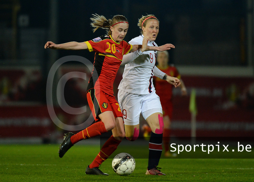 20140410 - LEUVEN , BELGIUM : Belgian Julie Biesmans (20) pictured with Norway Isabell Herlovsen (9)  during the female soccer match between Belgium and Norway, on the seventh matchday in group 5 of the UEFA qualifying round to the FIFA Women World Cup in Canada 2015 at Stadion Den Dreef , Leuven . Thursday 10th April 2014 . PHOTO DAVID CATRY