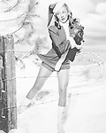 Woman in a Santa costume getting caught on a barbed wire fence