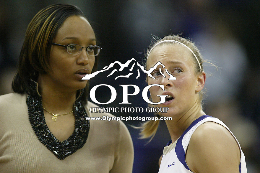 12 February 2010:  Washington Huskies head coach Tia jackson chats with guard #12 Sarah Morton on the sidelines during a break in action against Stanford. Stanford won 58-36 over Washington at the Bank of America Arena in Seattle, WA.
