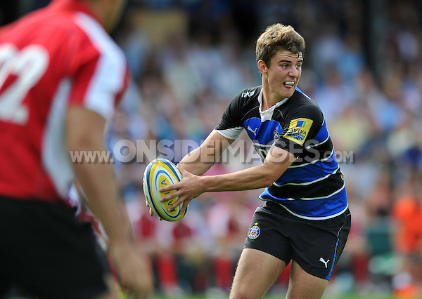 Ollie Devoto looks to pass the ball. Pre-season friendly match, between Bath Rugby and London Welsh on August 11, 2012 at the Recreation Ground in Bath, England. Photo by: Patrick Khachfe / Onside Images