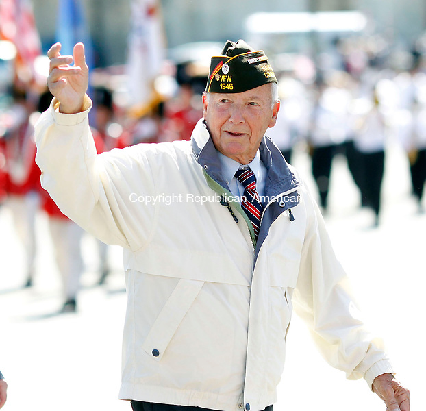 Naugatuck, CT- 27 May 2013-052713CM02-  Robert Burns, of Naugatuck, a World War II and Korean War veteran marches in the annual Memorial Day Parade in downtown Naugatuck Monday morning.    Christopher Massa Republican-American
