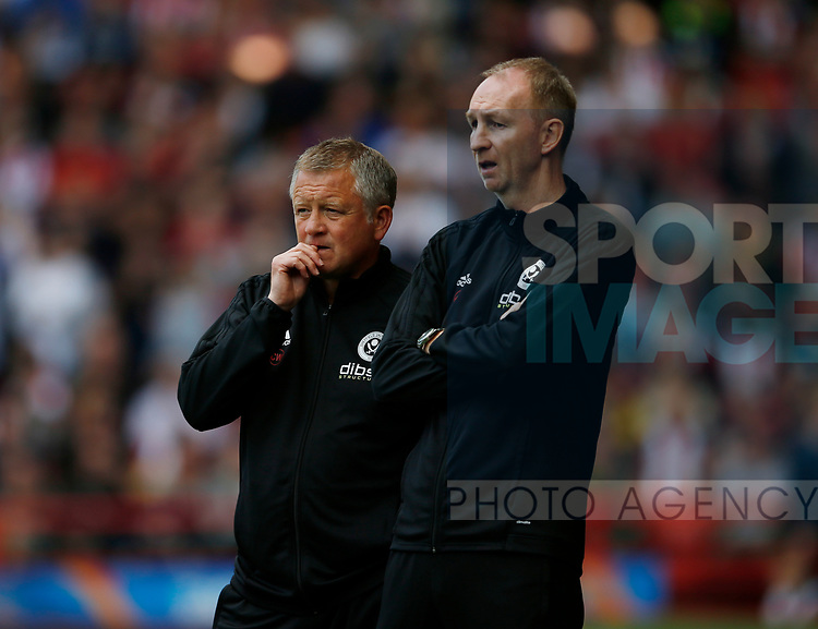 Chris Wilder manager of Sheffield Utd and Alan Knill Assistant manager of Sheffield Utd during the English Championship League match at Bramall Lane Stadium, Sheffield. Picture date: August 5th 2017. Pic credit should read: Simon Bellis/Sportimage
