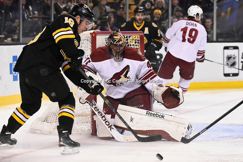 February 28, 2015 - Boston, Massachusetts, U.S. - Boston Bruins right wing Reilly Smith (18) and Arizona Coyotes goalie Mike Smith (41) in game action during the NHL match between the Arizona Coyotes and the Boston Bruins held at TD Garden in Boston Massachusetts. Eric Canha/CSM